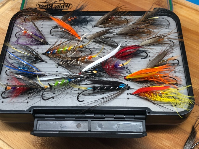 Box filled with Spey and Dee patterns for Pacific Northwest steelhead