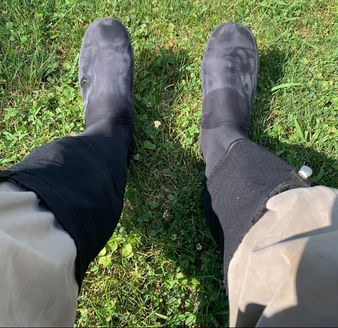 Feet with bags on them are now inside my waders ready to go fly fishing